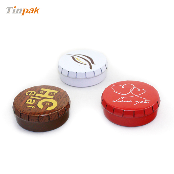 small round click clack mint candy tin box